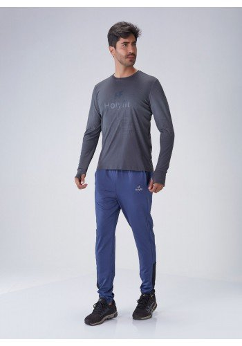 calca fitness masculino azul recorte lateral dry fit protecao uv50 holyfit frente
